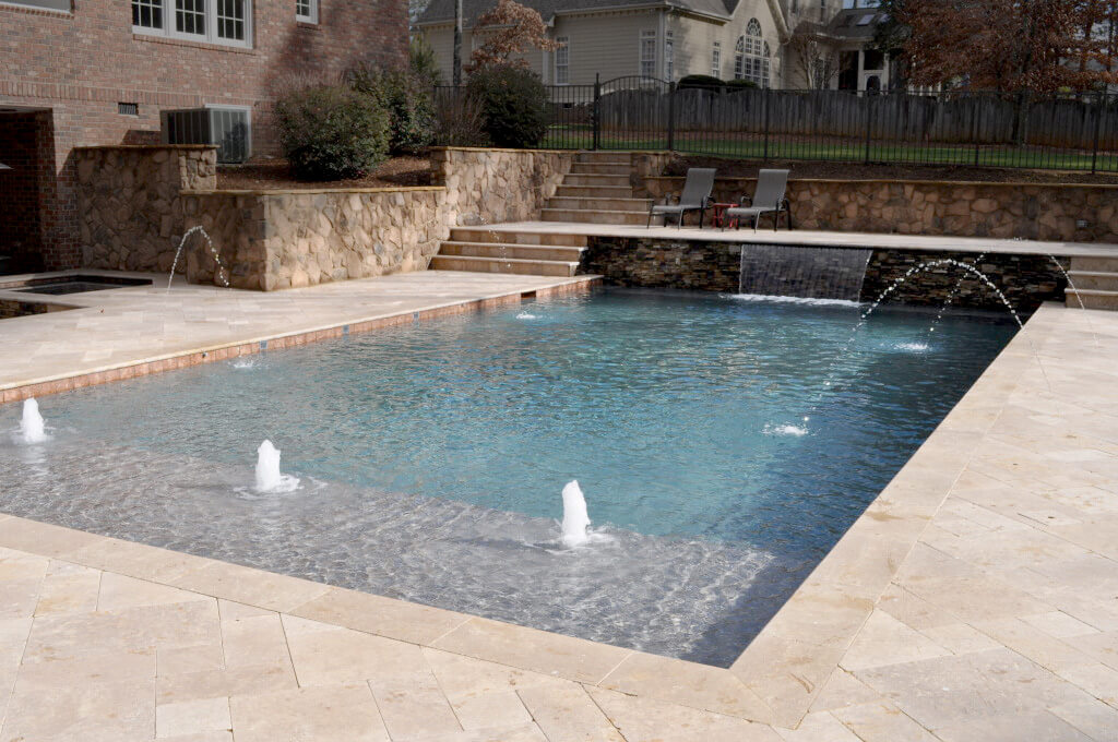 rectangular pool with water feature